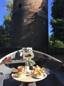 Norwich Rowing Boat in front of Cow Tower